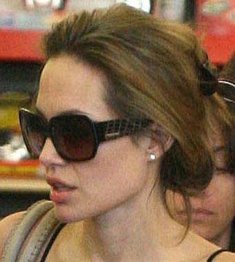 Анджелина Джоли и ее солнцезащитные очки