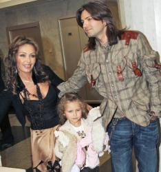 Дмитрий и Елена Маликовы с дочерью Стефанией